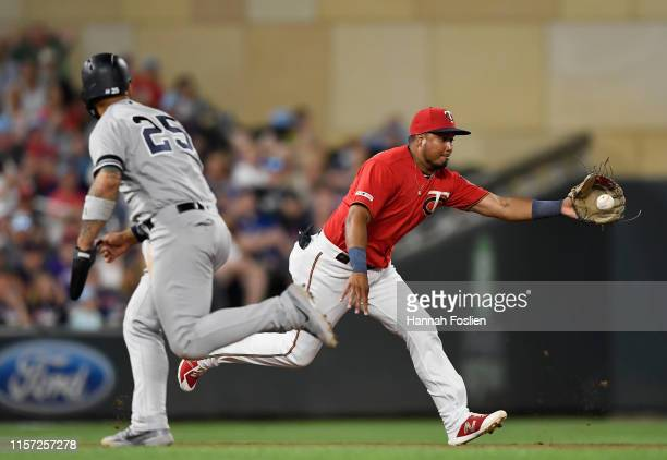 Gleyber Torres of the New York Yankees runs to third base as Luis Arraez of the Minnesota Twins fields the ball hit by Gio Urshela of the New York...