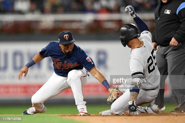 Gleyber Torres of the New York Yankees slides in safe on a double against the Minnesota Twins in the ninth inning in game three of the American...