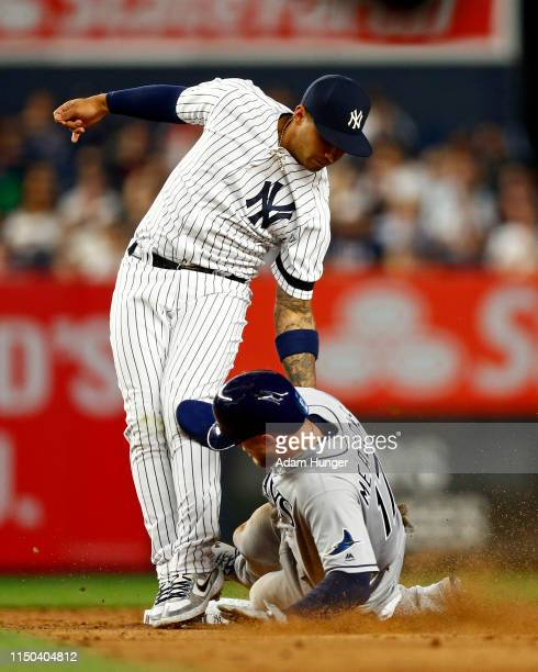 Gleyber Torres of the New York Yankees tags out Austin Meadows of the Tampa Bay Rays attempting to steal second base during the sixth inning at...