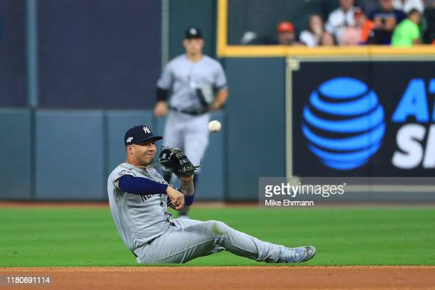 Gleyber Torres of the New York Yankees throws out the runner after making a diving stop against the Houston Astros during the first inning in game...