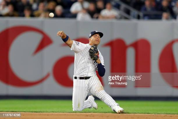 Gleyber Torres of the New York Yankees throws to first base for out during the game between the Boston Red Sox and the New York Yankees at Yankee...