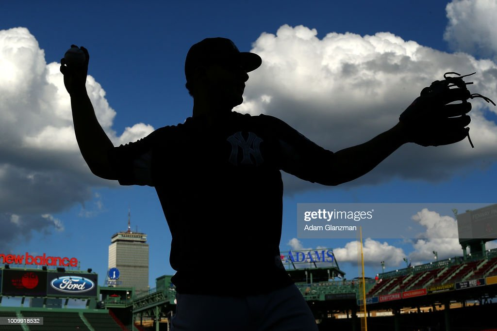 Gleyber Torres #25 of the New York Yankees warms up before a game against the Boston Red Sox at Fenway Park on August 2, 2018 in Boston, Massachusetts.