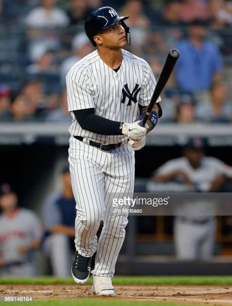Gleyber Torres of the New York Yankees watches the flight of his first inning three run home run against the Boston Red Sox at Yankee Stadium on July...