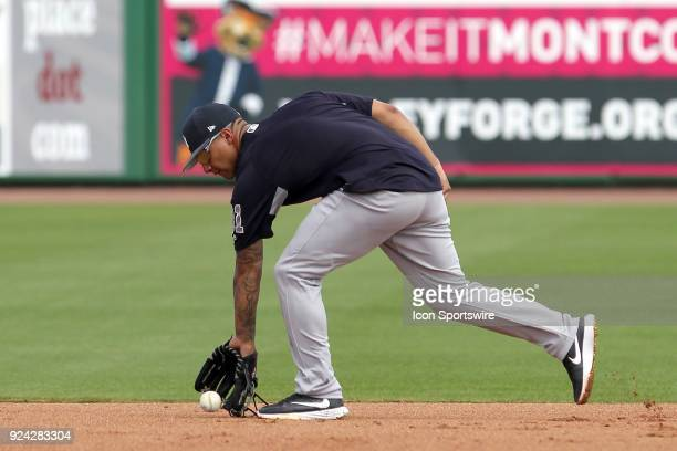 Gleyber Torres of the Yankees fields a ball during drills before the spring training game between the New York Yankees and the Philadelphia Phillies...