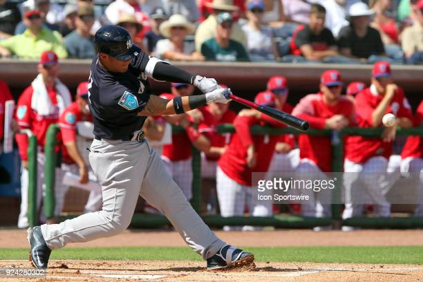Gleyber Torres of the Yankees hits a line drive thru the infield during the spring training game between the New York Yankees and the Philadelphia...