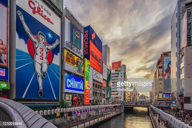 glico and advertising billboard signs landmark of dotonbori, shisaibashi shopping district, osaka, japan - 道頓堀 ストックフォトと画像