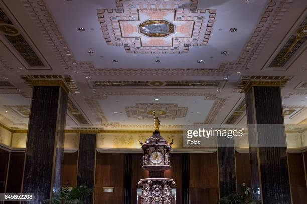 Glided statue of liberty sits atop the clock in the main lobby of of the Waldorf Astoria hotel on Park Avenue, Manhattan, February 25th 2017, the...