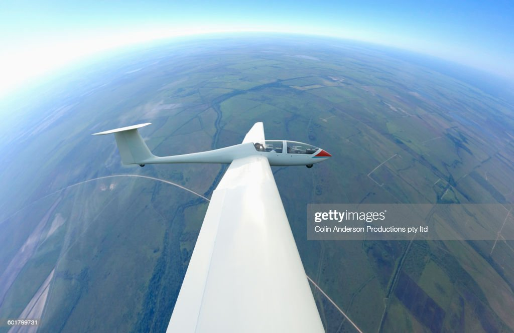 Glider airplane flying in sky : Stock Photo