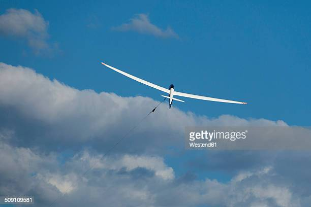 Glider at start in front of clouds
