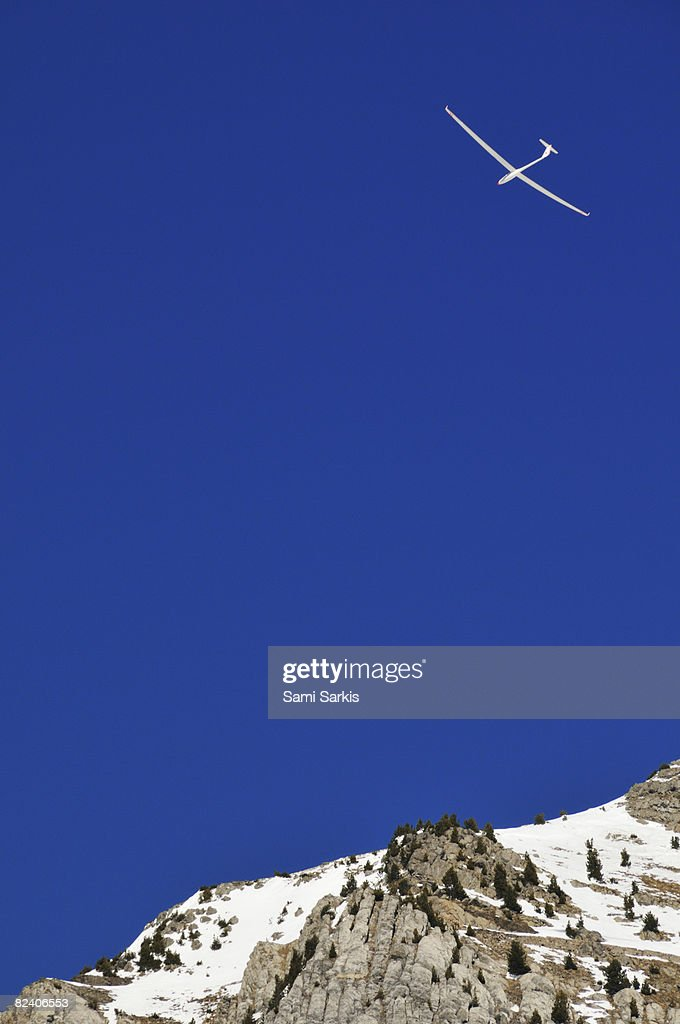 Glider flying over mountain, French Alps, France : Stock Photo