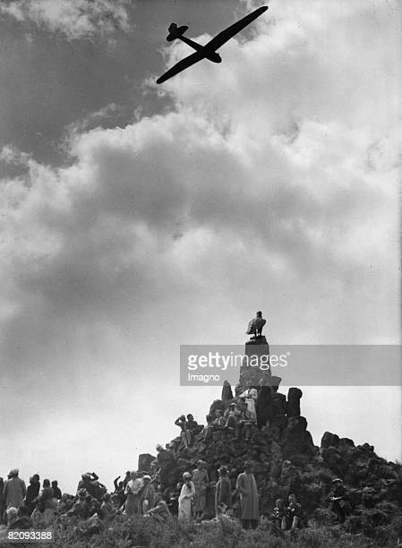 Glider over the Wasserkuppe in the Rhoen Mountains Competition of gliders Photograph Germany Around 1935 [Segelflugzeug ber dem Fliegerdenkmal in der...
