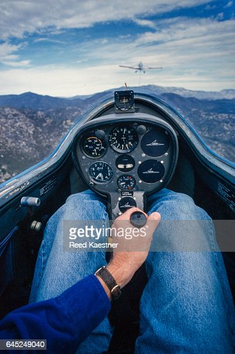 A glider pilot waits for the tow plane to bank away before unleashing the tow rope.
