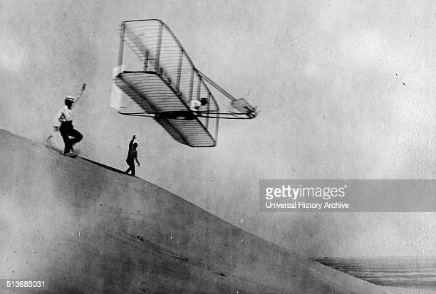 A glider test by the Wright Brothers performed off of what looks like a sand dune C1901 Two years before their first powered flight