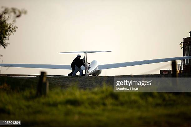 Gliders are moved into the hanger for the night at the Yorkshire Gliding Club which lies on a plateau in the North Yorkshire Moors National Park on...