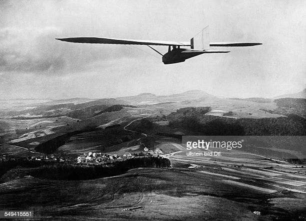 Gliding competitions in the Rhoen Mountains Germany gliderplane over the hills 1922 Photographer Sennecke Published by 'Vossische Zeitung' 43/1922...
