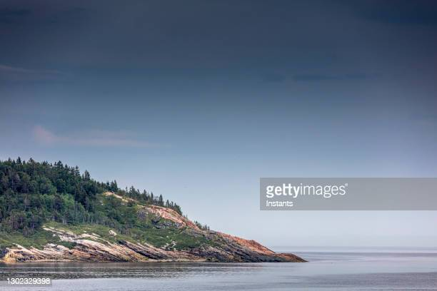 a glimpse at the scenery, from road 138, between baie saint-paul and la malbaie in the beautiful charlevoix region. - river st lawrence stock pictures, royalty-free photos & images