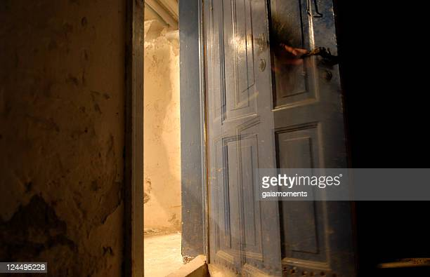 glimpse of a ghost? - magic doors stock pictures, royalty-free photos & images