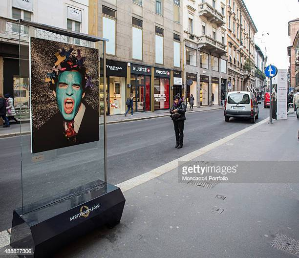 Glimpse of Monte Napoleone Street with a closeup of a Giovanni Gastel's work on the left thait is the unconventional portrait of a screaming model...