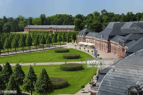 A glimpse of the French garden and some buildings of Schwetzingen Castle BadenWurttemberg Germany