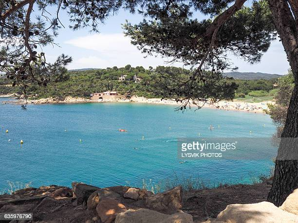 Glimpse of the sea and the sandy beach at Palamos
