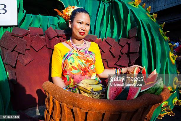 Glimpse showing woman selling fruits during a procession in a carnival Goa Carnivals Goa India