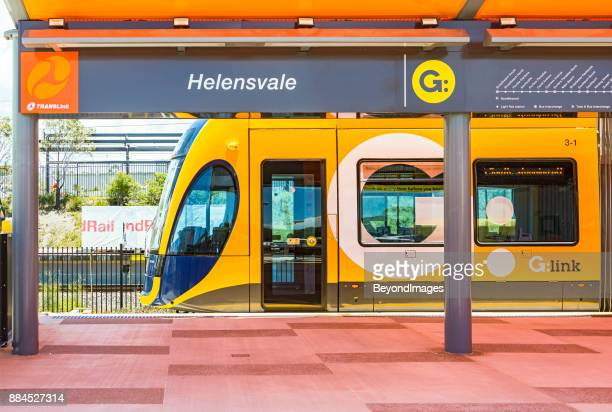 g:link tram waiting at new helensvale terminus and transport interchange - windbreak stock pictures, royalty-free photos & images