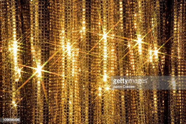 glitter curtain - gold background - fotografias e filmes do acervo