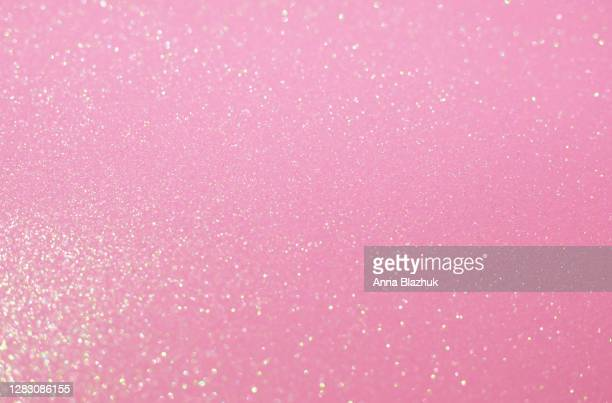 glitter festive pastel pink background with blurred sparkles, christmas, birthday or holiday background - pink colour stock pictures, royalty-free photos & images