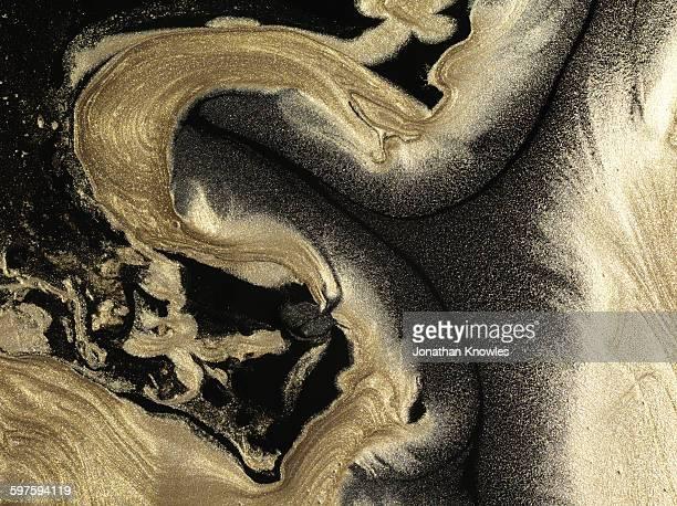 Glitter gold patterns on black background