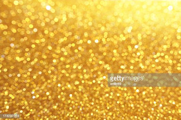 Glitter in gold coloration