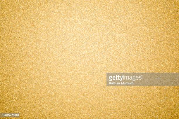 glitter sheet texture background - gold colored stock photos and pictures