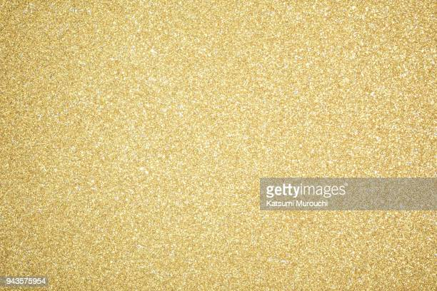 glitter sheet texture background - gold stock pictures, royalty-free photos & images