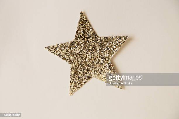 glitter star - star shape stock pictures, royalty-free photos & images