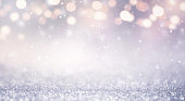 Glitter vintage lights abstract background new year holiday. Blue and gold, copy space.