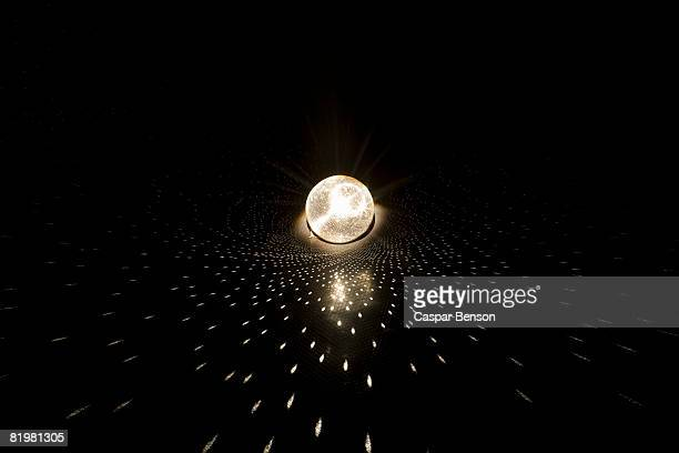 a glittering disco ball - mirror ball stock pictures, royalty-free photos & images