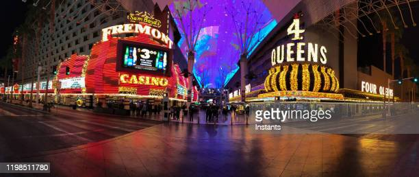 glittering facades of fremont and 4 queens casinos in downtown vegas. - fremont street experience stock pictures, royalty-free photos & images