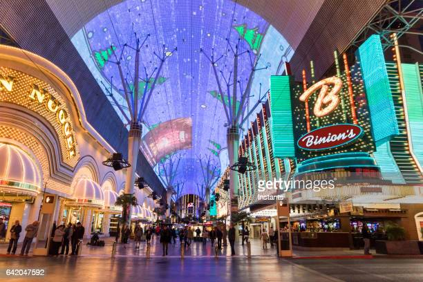 glittering facades the golden nugget and binion's hotels and casinos of fremont casino in downtown las vegas. - fremont street experience stock pictures, royalty-free photos & images