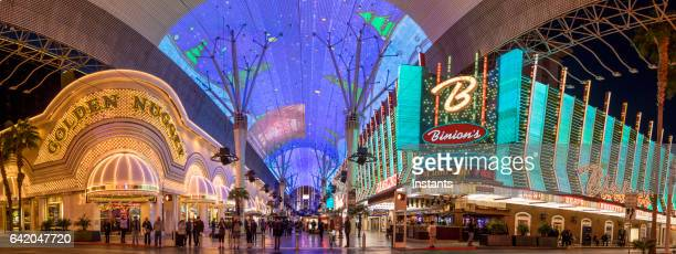 glittering facades the golden nugget and binion's hotels and casinos of fremont casino in downtown las vegas. - fremont street las vegas stock pictures, royalty-free photos & images