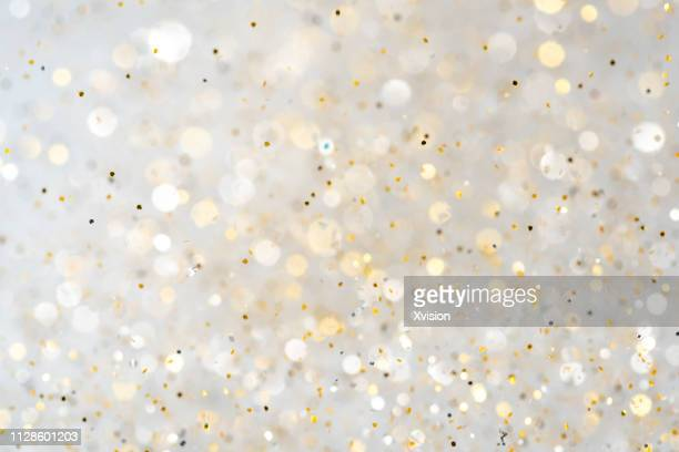 glittering golden and silver colorful shinny decoration background - spotted ストックフォトと画像
