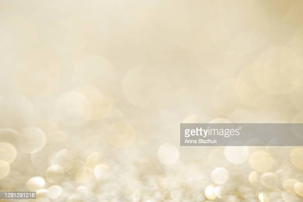 glittering golden and silver glowing shiny decoration background for holidays, new year and christmas - shiny stock pictures, royalty-free photos & images