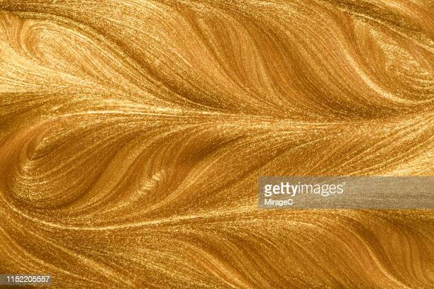 glittering golden metallic paint - bling bling stock pictures, royalty-free photos & images