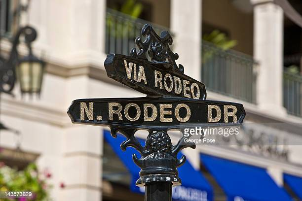 A glittering Rodeo Drive sign greets visitors on April 14 2012 in Beverly Hills California Millions of tourists flock to the Los Angeles area to...