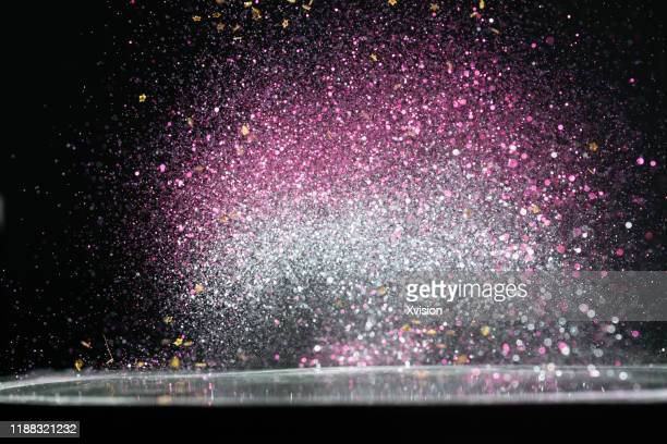 glittering small decoration plastic debris flying in mid air - silver coloured stock pictures, royalty-free photos & images