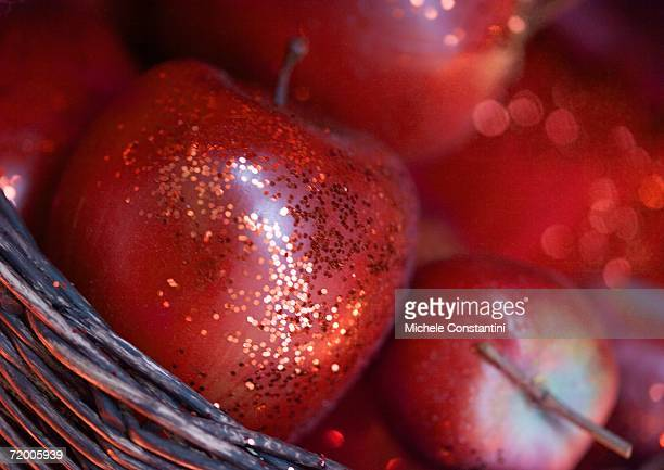 Glittery apples in basket
