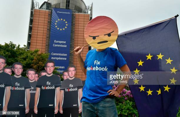 Global activists of Avaaz set up cardboard cutouts of Facebook chief Mark Zuckerberg on which is written Fix Fakebook in front of the European Union...