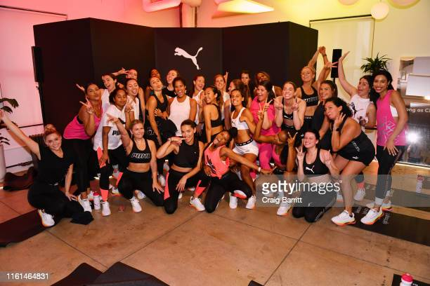 Global Ambassador Adriana Lima, Deja Riley and workout class participants pose as PUMA And Refinery29 Host The Launch Of The New PUMA LQD CELL...