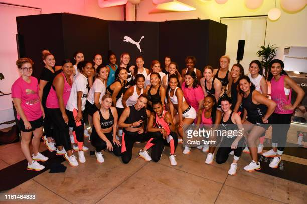 Global Ambassador Adriana Lima Deja Riley and workout class participants pose as PUMA And Refinery29 Host The Launch Of The New PUMA LQD CELL Shatter...