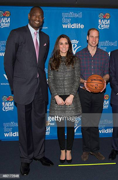 NBA Global Ambassador Dikembe Mutombo Catherine Duchess of Cambridge and Prince William Duke of Cambridge at Barclays Center on December 8 2014 in...