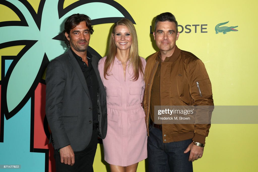 Global CEO Thierry Guibert (L), Gwyneth Paltrow, and Robbie Williams attend the celebration of the re-opening of the LACOSTE Rodeo Drive Boutique at Sheats Goldstein Residence on November 7, 2017 in Los Angeles, California.