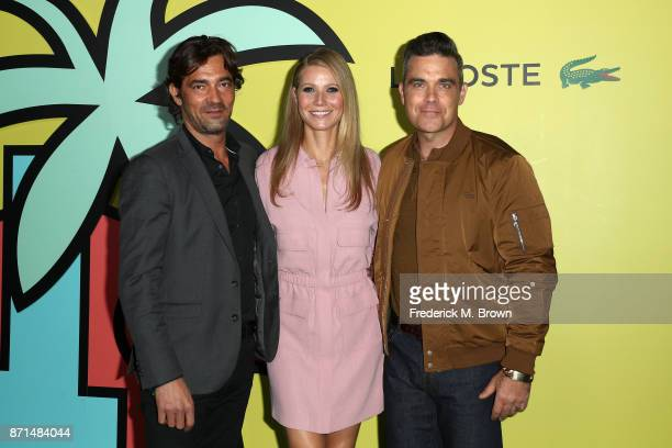 Global CEO Thierry Guibert Gwyneth Paltrow and Robbie Williams attend the celebration of the reopening of the LACOSTE Rodeo Drive Boutique at Sheats...